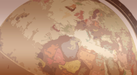 Part of a sepia-toned globe, roughly displaying the outlines of countries in Africa and Europe.