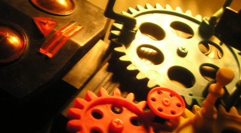 Close-up image of a toy robot with large, exposed gears on its chest.