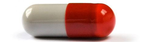 Close-up image of a single pharmaceutical caplet.