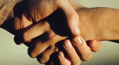 Close-up image of two people shaking hands.