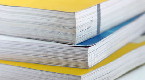 A stack of three notebooks.