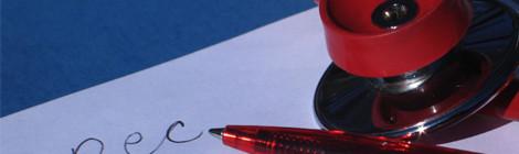 A stethoscope and a pen sit atop a prescription pad.