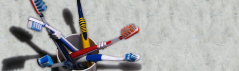 Multiple-colored toothbrushes sit in a cup on a bathroom counter.