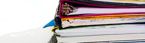 A close-up image of a stack of notebooks.