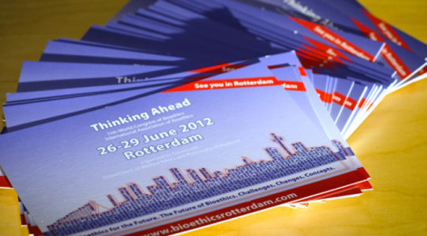 Several postcards marketing the IAB the conference arranged in a fan on a table.